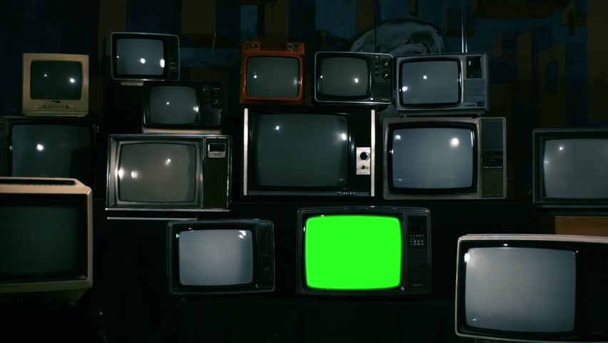80s Televisions with Green Screens that Turn On. Blue Steel Tone. Zoom Out. Ready to replace green screen with any footage or picture you want.  | Shutterstock HD Video #1010083550