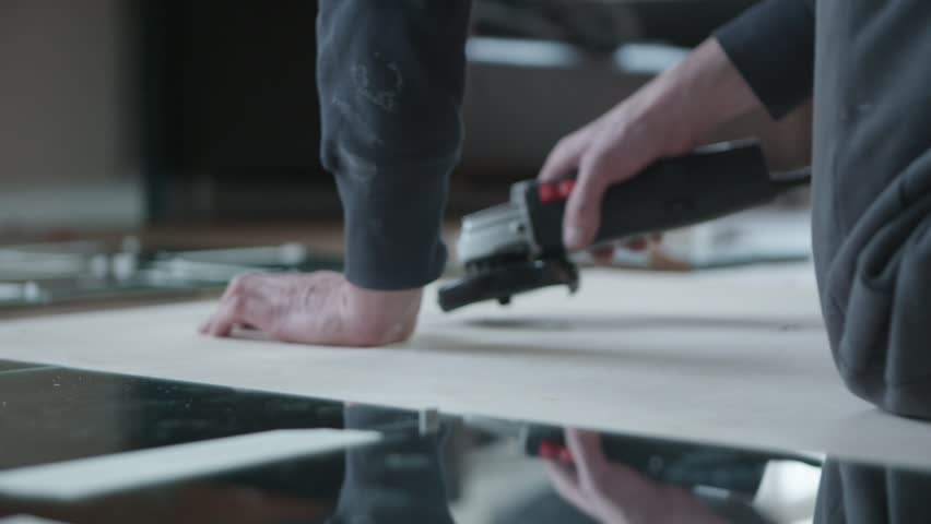 Male hands glueing square mirrors. Design, decoration and manual work concept.