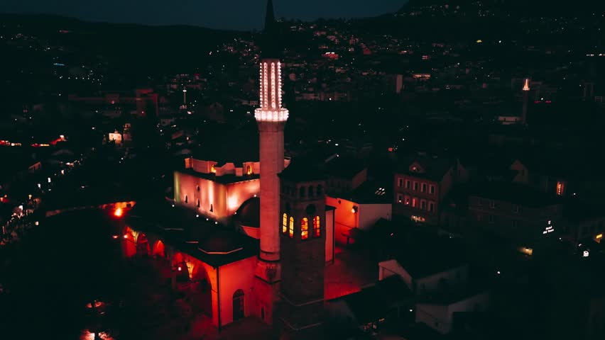Aerial footage of the Sarajevo, capital of Bosnia and Herzegovina. Video made during golden hour. In the shift of day and night.