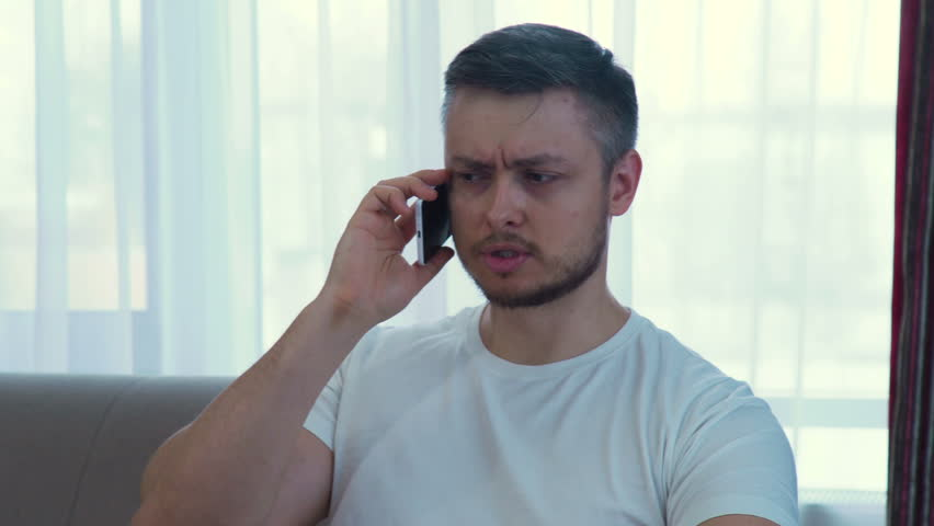 Technology communication. irritated annoyed angry adult caucasian man ending an unpleasant phone call | Shutterstock HD Video #1010108510