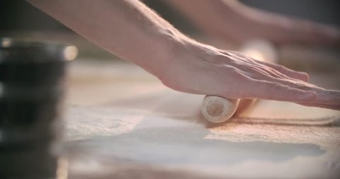 Rolling out a dough in slow motion