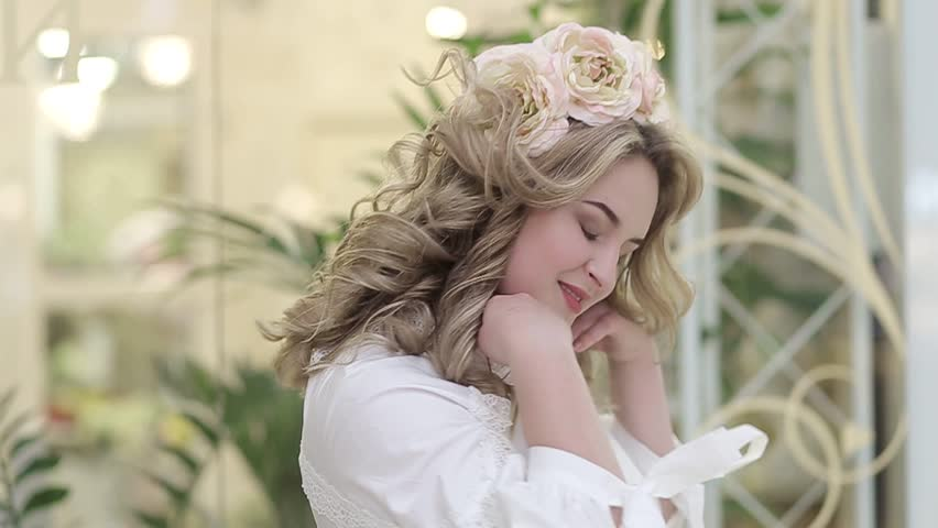 Beautiful girl with flowers on her head | Shutterstock HD Video #1010117990