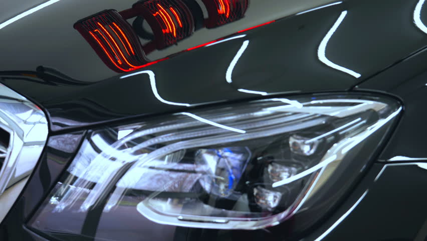 Red ceramic lamps, black auto, car workshop car wash machines.   Shutterstock HD Video #1010120420