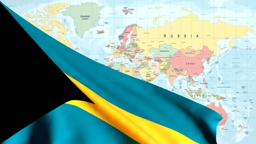 The waving flag of the Bahamas opens up the view to the position of the Bahamas on a colored world map