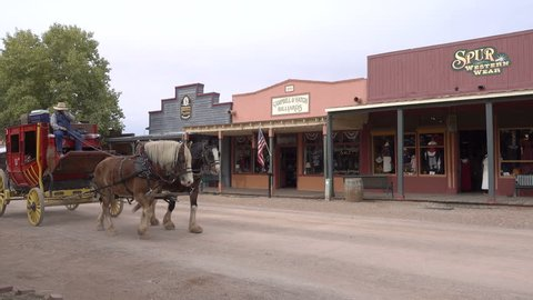 TOMBSTONE, ARIZONA/USA - NOVEMBER 07, 2017: Tourists ride on Stagecoach in Tombstone. Tombstone is a historic city founded in 1879, one of the last boomtowns in the American frontier.