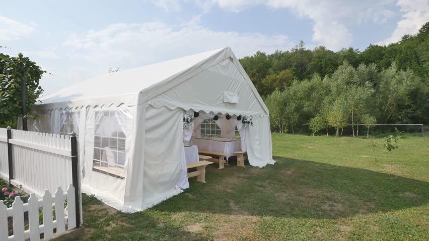 Beautiful Banquet hall under a tent for a wedding reception | Shutterstock HD Video #1010133860