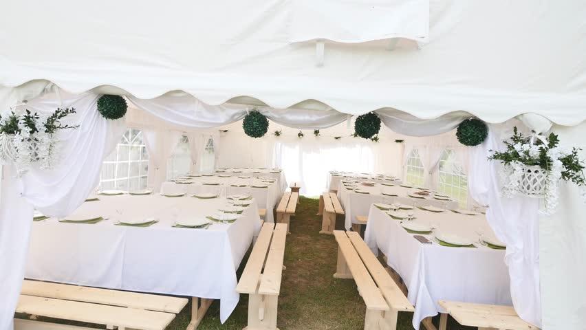 Beautiful Banquet hall under a tent for a wedding reception | Shutterstock HD Video #1010133920