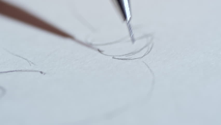 Extreme close up of unrecognizable graphic designer using gray pencil when drawing sketch for future picture | Shutterstock HD Video #1010145530
