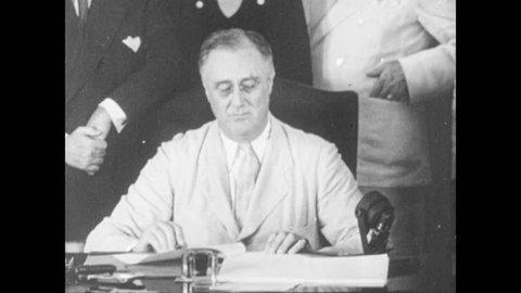 1940s: President Roosevelt sits at desk, speaks.