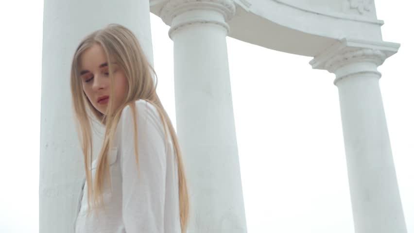 Summer lifestyle fashion portrait of young beautiful blonde stylish hipster woman wearing white shirt   Shutterstock HD Video #1010148260