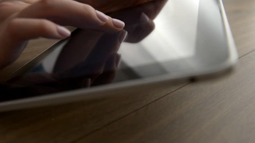 Finger touching tablet computer touchscreen | Shutterstock HD Video #1010180420
