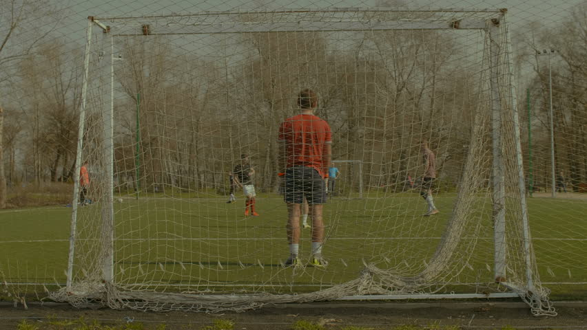 Attacking team creating opportunity to score a goal during football training match on soccer pitch. Young soccer forward dribbling, getting past defender and scoring a goal during football training. | Shutterstock HD Video #1010180840