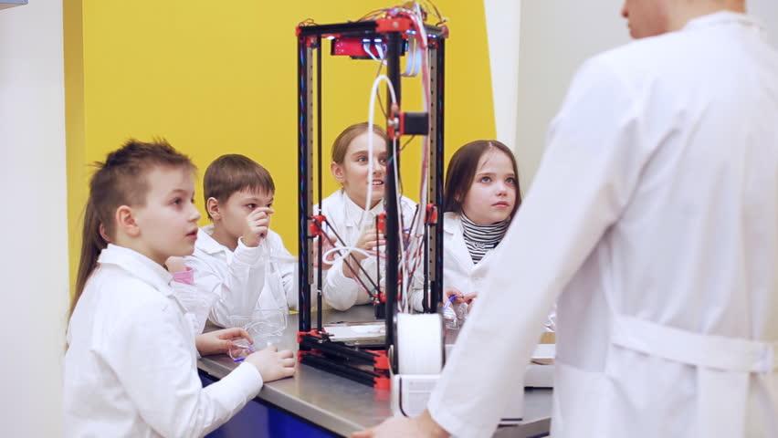Children around 3D printer study modern technology | Shutterstock HD Video #1010184230