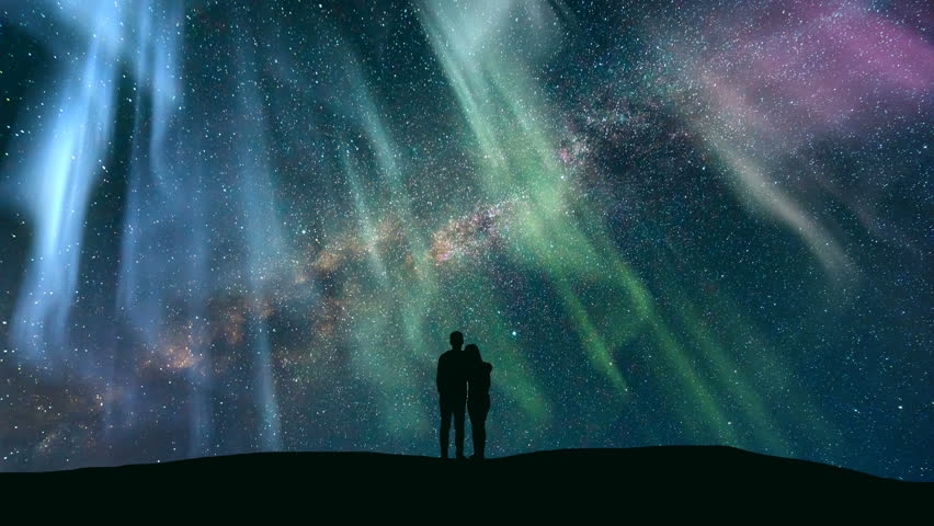 The couple standing against the northern light with a northern light. time lapse | Shutterstock HD Video #1010184650