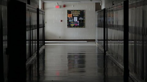 Shot of a school hallway with metal lockers
