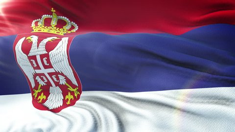 Flag of Serbia waving on sun. Seamless loop with highly detailed fabric texture. Loop ready in 4k resolution.