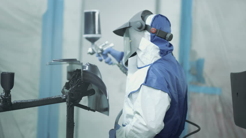 Car manufacturing facility and production factory. People working on sports vehicles.   Shutterstock HD Video #1010310740