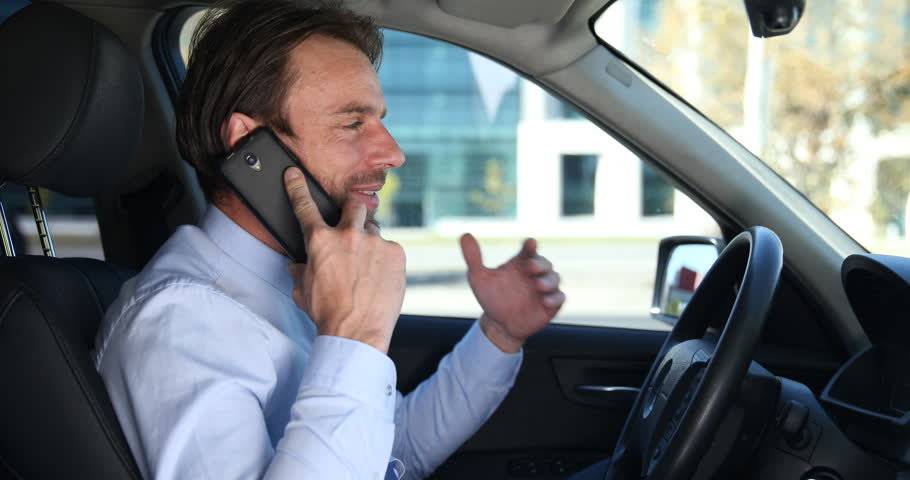 Happy Business Man Talk Mobile Phone Positive Partnership Dialogue in Luxury Car