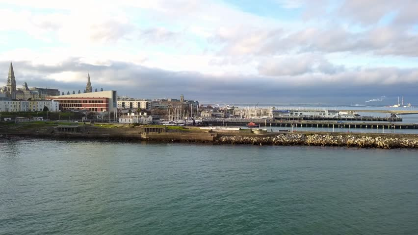 Stunning 4k aerial drone video of seaside during a sunny day in Dun Laoghaire, Dublin, Ireland with boats and yachts and ancient buildings | Shutterstock HD Video #1010361860