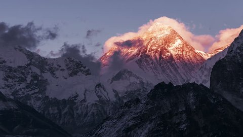 Greatness of nature: time lapse grandiose view of Everest peak (8848 m) at sunset. Nepal, Himalayan mountains, the highest point of the planet.