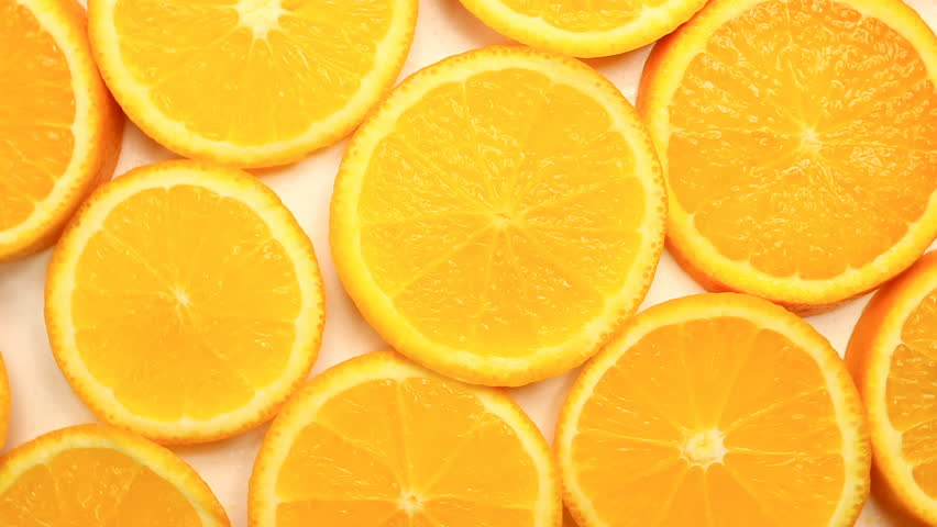 Fresh citrus fruits. Rotate Video footage of the concept of a healthy food and diet. Spinning sliced oranges | Shutterstock HD Video #1010401820