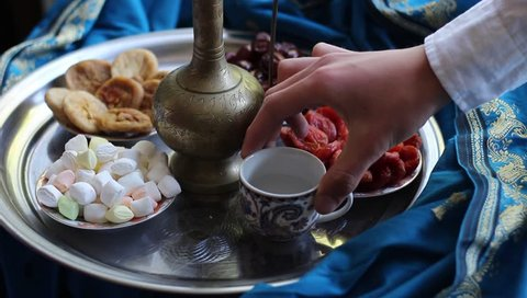 Muslim family. Iftar break fast spread consists of water, dates, dried apricots. Traditional Dishes to Serve During Ramadan