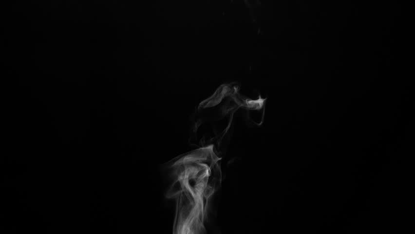 Steam from a Cup of Hot Water. White steam rises light, graceful twists on a black background. The jet lifted out of the cup of hot water. Shooting at a rate of 120fps. Footage is perfect for the top  #1010409620
