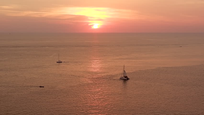 Beautiful sunset on summer day, calm sea wave with boat sailing and fishing boat over sea surface in high view. | Shutterstock HD Video #1010412320