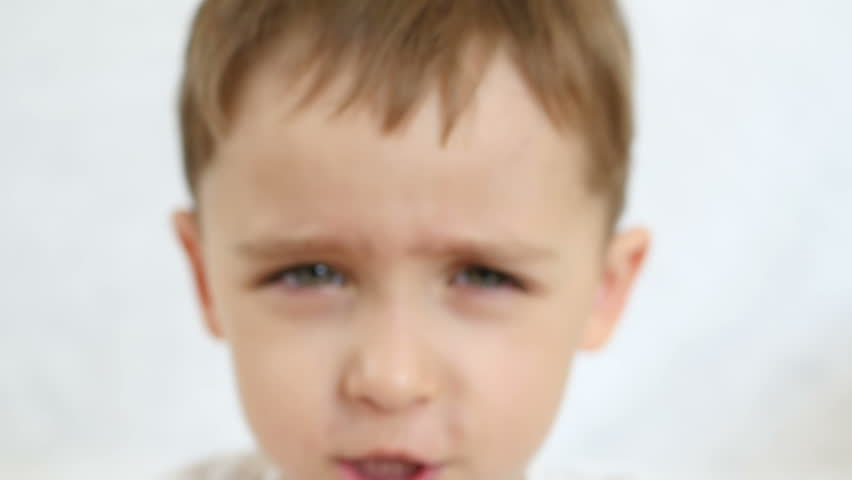 Face and eyes of a child close-up in a slow motion   Shutterstock HD Video #1010416700