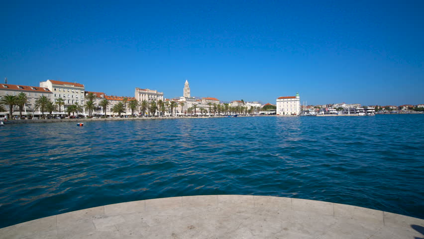 Woman traveller travels in Split,Croatia with panoramic view of Split old town. Split is the second-largest city of Croatia and prominent travel destination for historic center of Croatia cultures. #1010428670