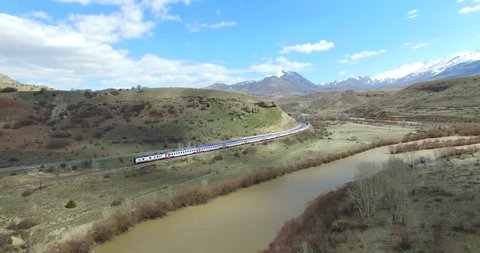 Aerial view of passenger train crossing the countryside. Erzincan,Turkey 07.02.2018