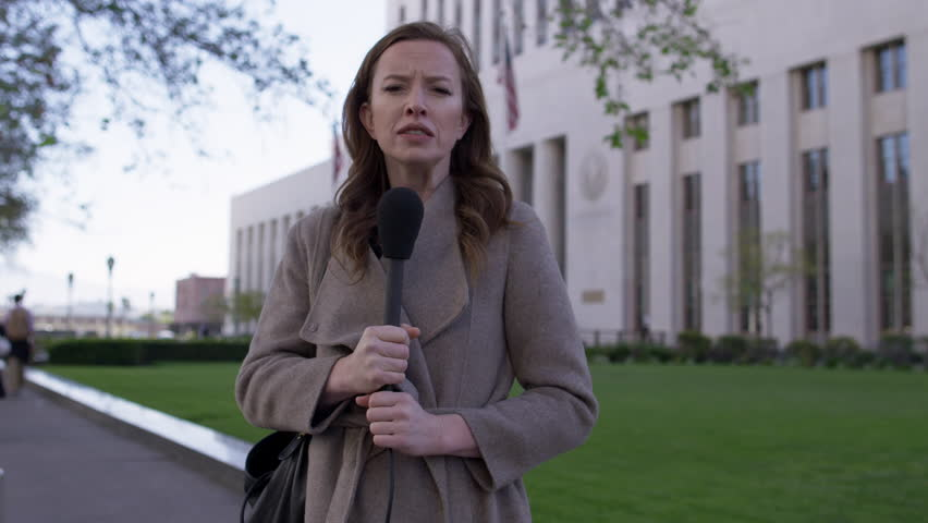 MS smartly dressed female TV journalist talks with microphone in front of old Federal Court building in Downtown Los Angeles. Hand-held, real time 4K UHD. Mute | Shutterstock HD Video #1010440610