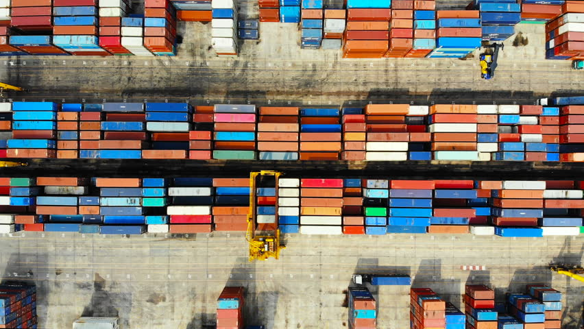 Commercial port with Logistics and transportation of Container Cargo ship and Cargo import/export and business logistics,Aerial view footage  | Shutterstock HD Video #1010451110