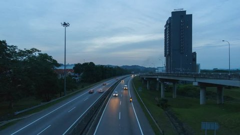 Johor Bahru - March 2018 - Timelapse of sunset over a busy highway at Nusajaya, Johor Bahru. May contain noise due to low lighting condition.