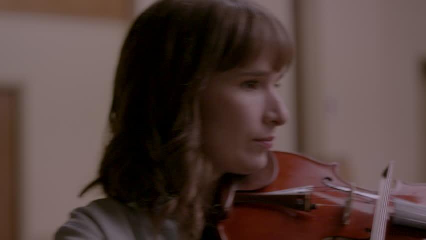 Musician playing violin happily HD stock video. Alexa camera