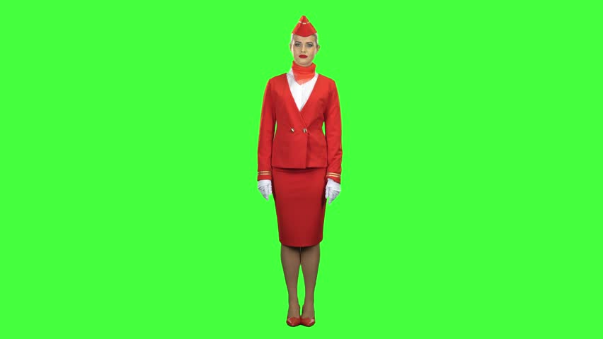 Stewardess shows with a gesture that everyone would stay on the ground. Green screen