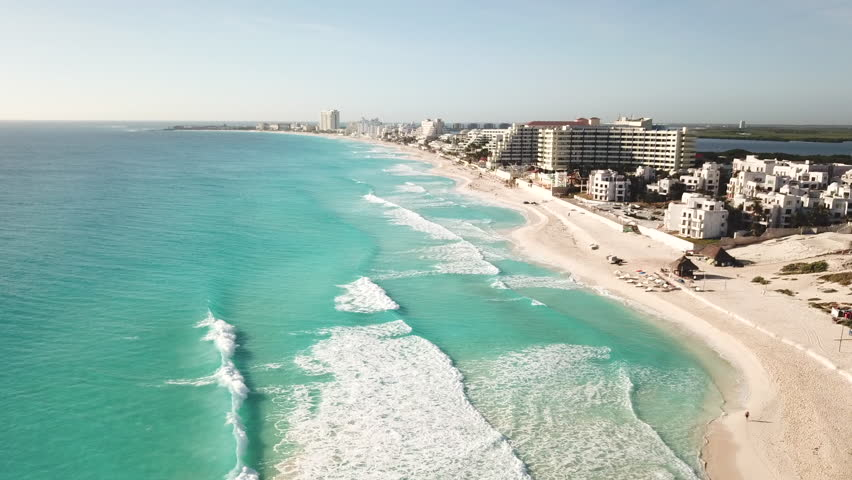 Cancun beach panorama aerial view. Aerial view of Caribbean Sea beach. Zona hotelera top view.  Beauty nature landscape with tropical beach. Caribbean seaside beach with turquoise water and big wave | Shutterstock HD Video #1010564900
