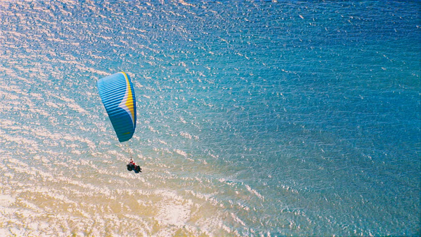 Paragliding Above Beach Stock Footage Video (100% Royalty-free) 1010572910    Shutterstock