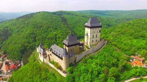 Camera flight around The Karlstejn castle. Royal palace founded King Charles IV. Amazing gothic monument in Czech Republic, Europe.