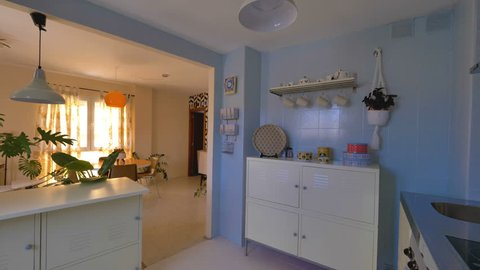 Real estate virtual tour. Camera fly-through the interior of a retro decorated home. Vintage living room and kitchen.