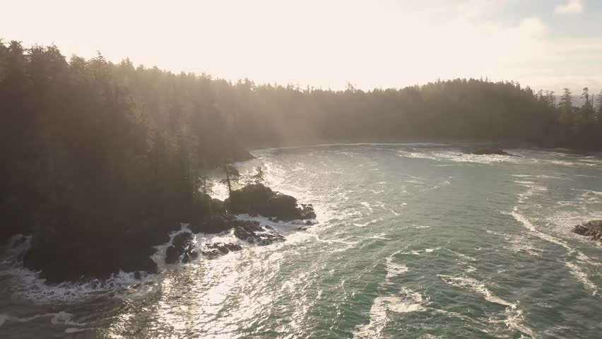Aerial view of the beautiful Seascape at the Pacific Ocean Coast during a vibrant winter sunrise. Taken near Tofino and Ucluelet in Vancouver Island, British Columbia, Canada.