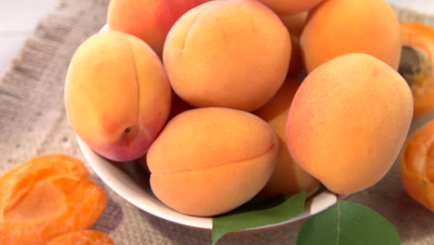 Apricot. Ripe organic apricots in a bowi rotates 360 loop-able.  High speed camera shot. Full HD 1080p.