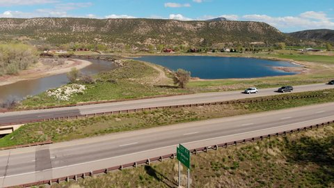 Drone footage captured on ascent near a lake and I-70 in the vicinity of De Beque, Colorado.