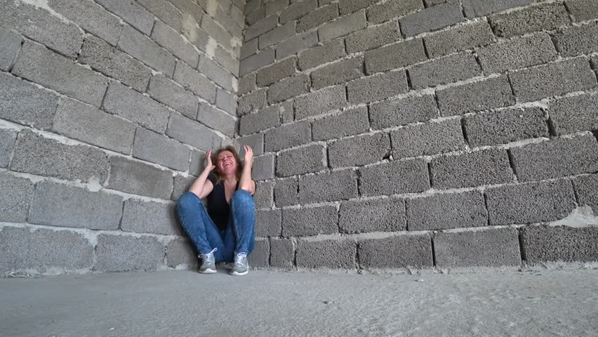 desperate unhappy woman by the wall. 4k, the concept of stress and hopeless #1010730080