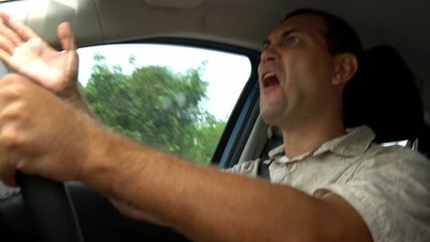 Angry Man Annoyed While Driving a Car. Agrressive Driver Irritated with Traffic