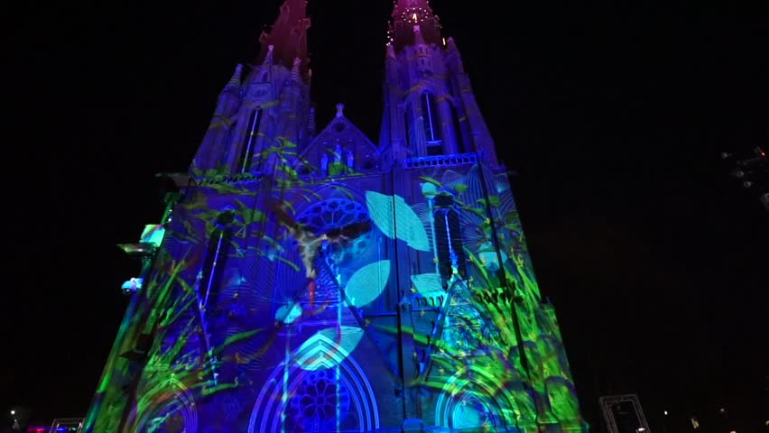Beautiful projected light on a church with birds, butterflies and grass. Eindhoven. The Netherlands. november 2017.