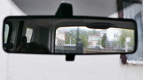 View of the rain from the rear view mirror