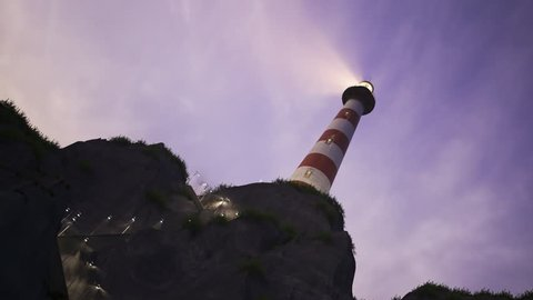 Beam of light from lighthouse rotating over the sea during sunset. Loopable animation.