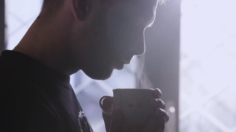 Man Inhales Aroma Of His Fresh Made Cup Of Coffee