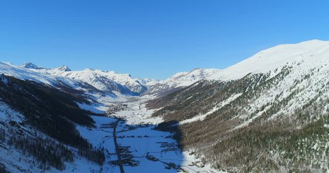 Vertical aerial view of livigno valley in winter, an amazing view of Livigno in a nice day